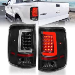 FORD F-150 04-06 LED TAIL LIGHTS BLACK HOUSING CLEAR LENS (W/ C LIGHT BAR)
